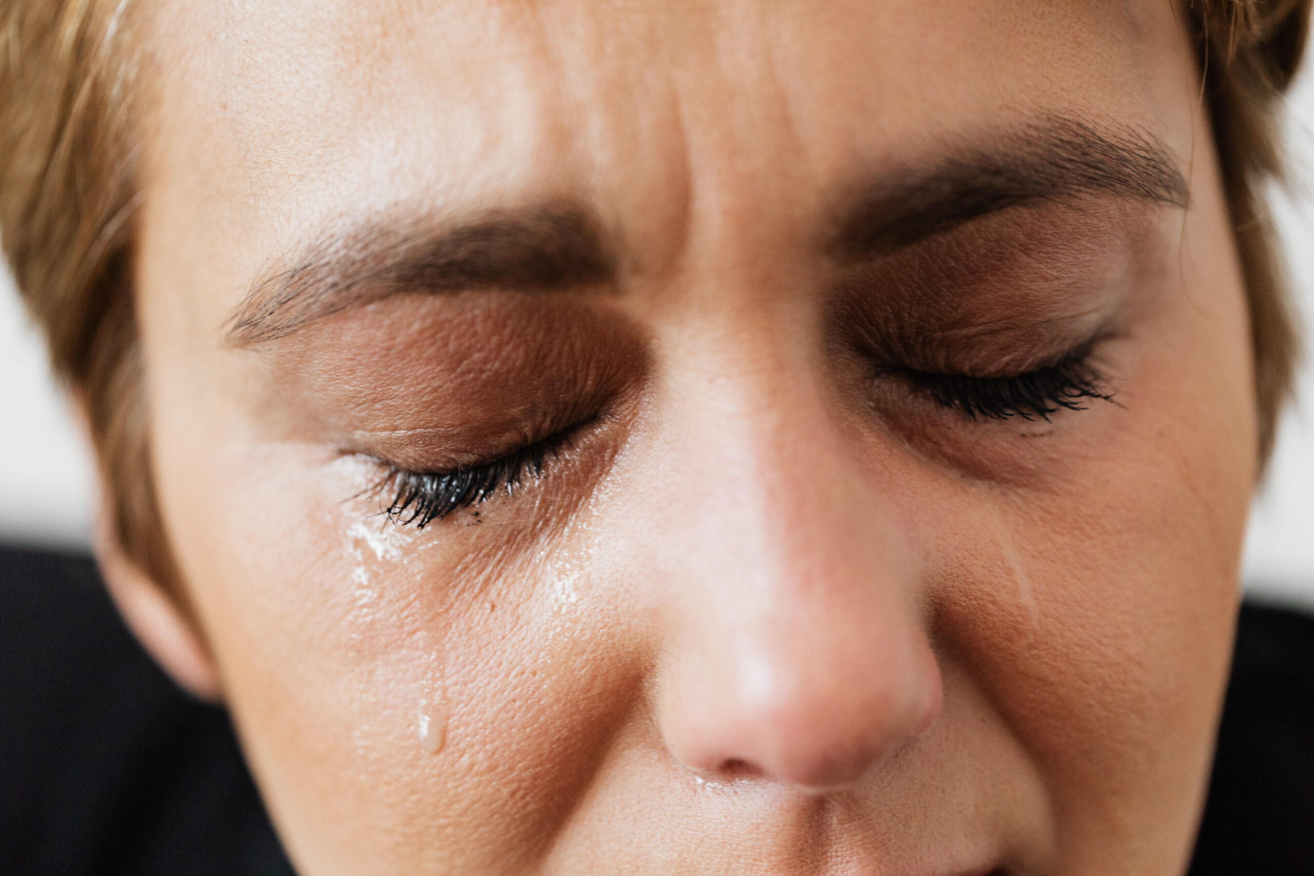 tears-on-face-of-crop-anonymous-woman-4471315